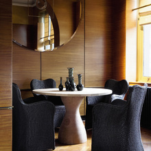 The same clever style as the larger lounge chair, the Butterfly dining chair in a dramatic dark shade of Lloyd loom