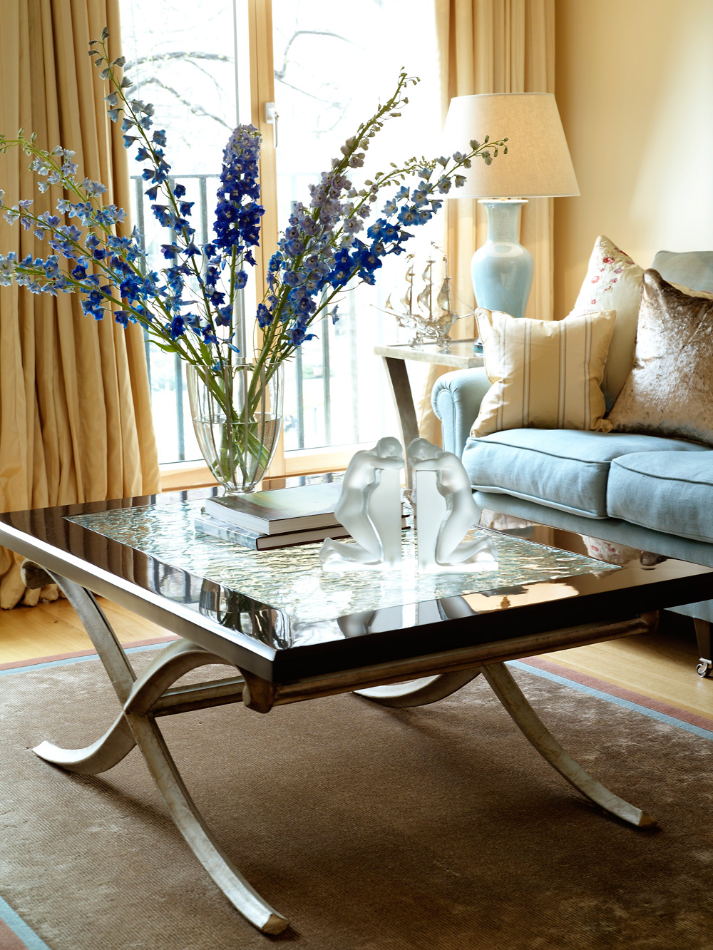 Westminster apartment sitting room table with delphiniums
