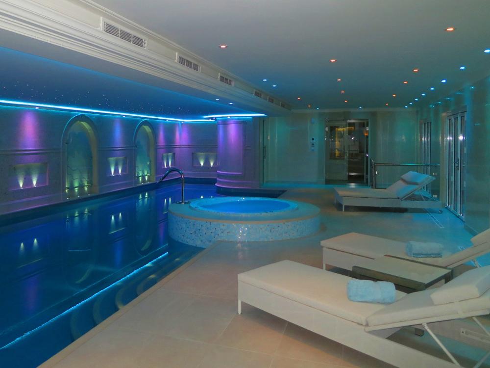 Jenny Blanc Blog - Illuminated Glass Art Set into Niches Along the Pool